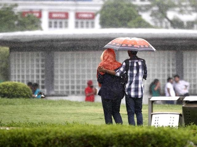 A-couple-enjoys-the-sudden-rains-that-lashed-the-national-capital-on-Thursday-Virendra-Singh-Gosain-HT