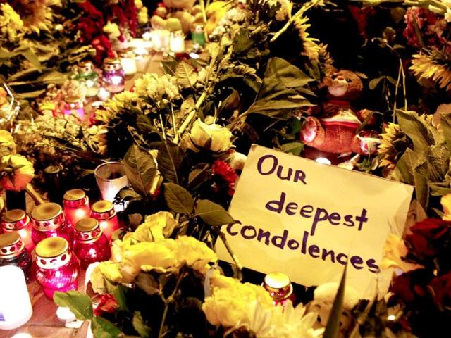 A-message-of-condolence-is-left-among-candles-and-flowers-near-the-Dutch-embassy-for-victims-of-Malaysia-Airlines-MH17-Reuters-Photo