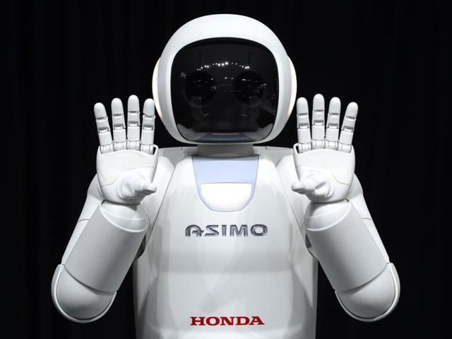 Honda-North-America-shows-off-their-new-Asimo-Robot-Photo-AFP-Timothy-A-Clary