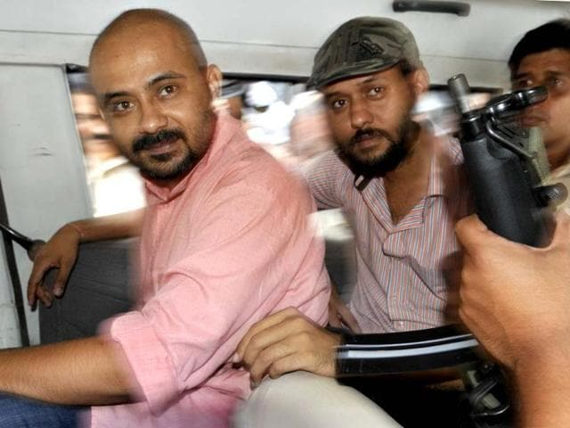 AAP-members-Dilip-Pandey-left-and-Javed-Ahmed-being-taken-to-Saket-Court-in-New-Delhi-on-Saturday-Sushil-Kumar-HT
