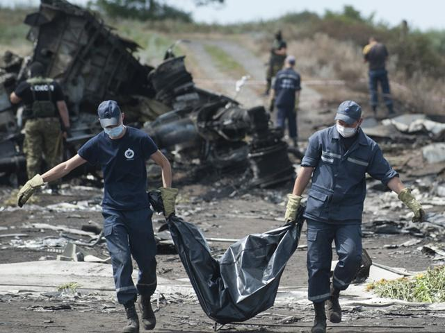 A-guard-stands-on-a-train-carrying-the-remains-of-victims-of-Malaysia-Airlines-MH17-downed-over-rebel-held-territory-in-eastern-Ukraine-after-it-arrived-in-the-city-of-Kharkiv-eastern-Ukraine-Reuters
