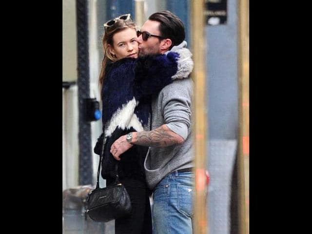 Behati-Prinsloo-and-Adam-Levine-Getty-Images