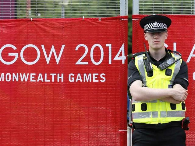 A police officer provides security around the perimeter in preparation for the Commonwealth Games in Glasgow. REUTERS PHOTO