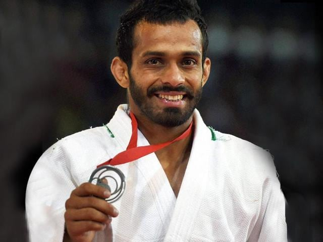 Navjot-Chana-shows-his-silver-medal-during-the-medal-ceremony-of-60kg-men-s-Judo-event-at-the-Commonwealth-Games-in-Glasgow-Scotland-PTI-photo