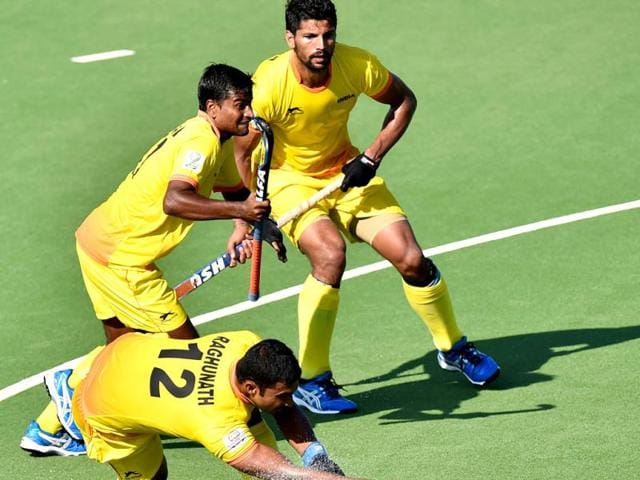 India-s-Rupinder-Singh-T-and-Danish-Mujtaba-C-look-on-as-Raghunath-Vokkaliga-Ramachandra-below-strikes-the-ball-during-their-men-s-field-hockey-match-between-against-Wales-at-the-Glasgow-Commonwealth-Games-AFP-Photo