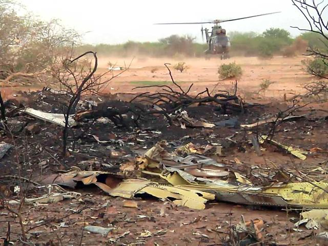 This-photo-provided-by-the-French-army-shows-a-helicopter-at-the-site-of-the-plane-crash-in-Mali-French-soldiers-secured-a-black-box-from-the-Air-Algerie-wreckage-site-in-a-desolate-region-of-restive-northern-Mali-on-Friday-the-French-president-said-AP-Photo