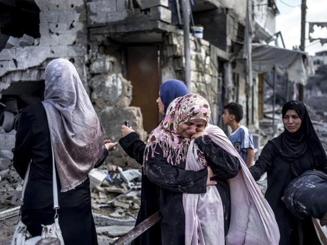 Palestinian-women-react-amid-the-destruction-in-the-northern-district-of-Beit-Hanun-in-the-Gaza-Strip-during-an-humanitarian-truce-AFP-photo
