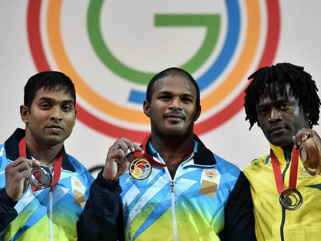 Gold-medalist-Sathish-Kumar-Sivalingam-C-and-silver-medalist-Ravi-Kumar-Katulu-L-with-Australia-s-bronze-medalist-Francois-Etoundi-pose-after-the-weightlifting-77kg-class-at-the-SECC-Precinct-during-the-2014-Commonwealth-Games-in-Glasgow-AFP-Photo