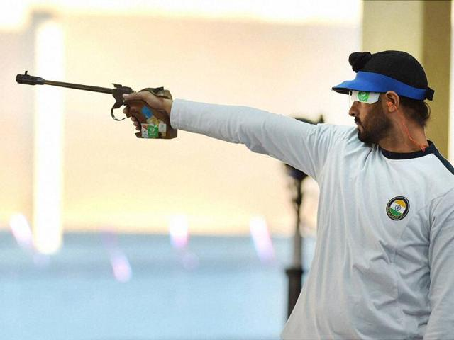 Gurpal Singh competes in the 50m Pistol final event during the Commonwealth Games at Barry Buddon Shooting Centre in Glasgow, Scotland. (PTI Photo)