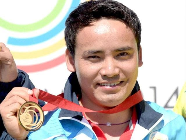 Jitu Rai celebrates after winning the gold medal in the 50m Pistol event during the Commonwealth Games at Barry Buddon Shooting Centre in Glasgow, Scotland. (PTI Photo)