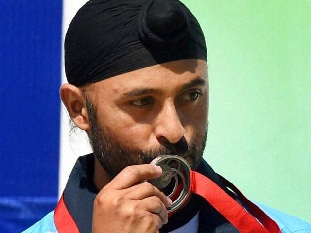 Gurpal Singh celebrates after winning the silver medal in the 50m pistol event during the Commonwealth Games at Barry Buddon Shooting Centre in Glasgow, Scotland. (PTI Photo)