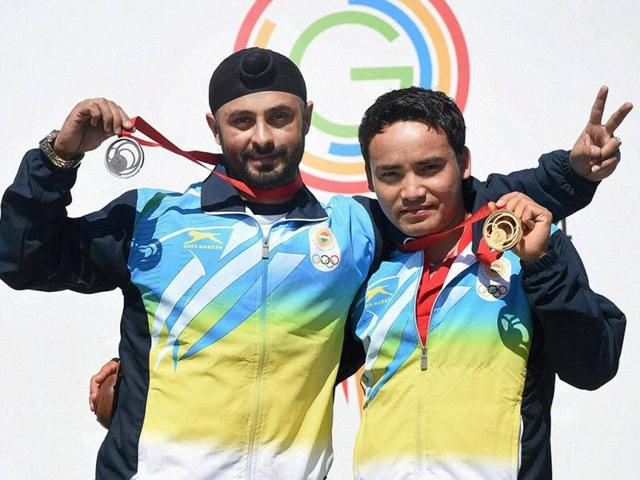 Jitu Rai (R) and Gurpal Singh celebrate after winning gold and silver medals respectively in the 50m pistol event during the Commonwealth Games at Barry Buddon Shooting Centre in Glasgow, Scotland. (PTI Photo)