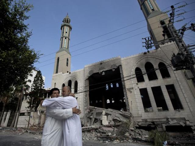 Palestinians react in front of a destroyed mosque after it was hit by an Israeli air strike on July 29, 2014, in Gaza City. (AFP/Mahmud Hams)