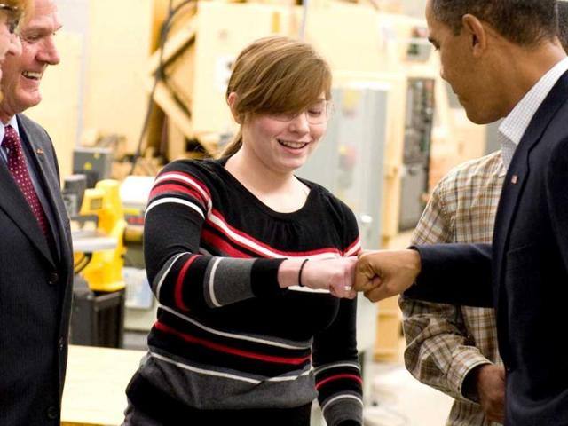 US-President-Barack-Obama-gives-a-student-a-fist-bump-while-touring-a-US-college-AFP