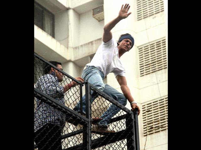 Actor-Shah-Rukh-Khan-waves-as-he-greets-fans-gathered-outside-his-residence-on-Eid-al-Fitr-in-Mumbai-on-Tuesday-PTI