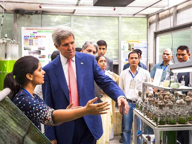 US secretary of state John Kerry speaks with graduate students about their work at the Indian Institute of Technology. AFP