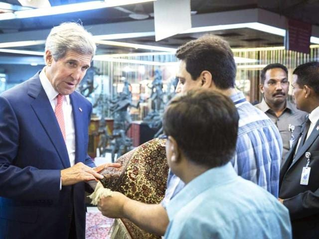 US secretary of state John Kerry visits the central cottage industries emporium marketplace in New Delhi. AFP