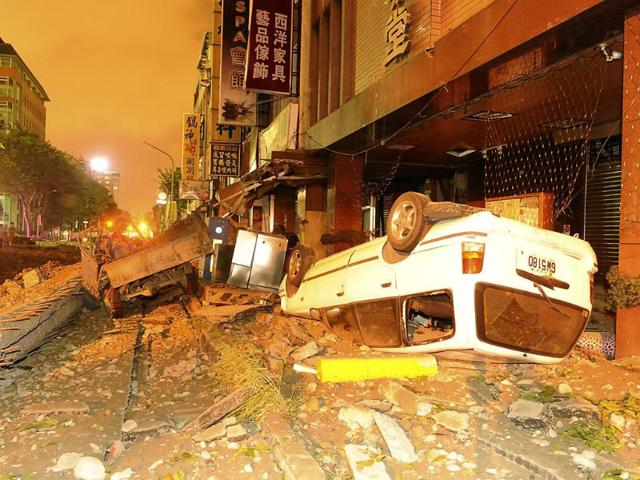 Wreckage-of-vehicles-are-seen-amongst-debris-after-an-explosion-in-Kaohsiung-southern-Taiwan-Reuters-photo