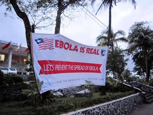 A-banner-reading-Lets-prevent-the-spread-of-Ebola-in-front-of-the-city-hall-in-Monrovia-Liberia-AP-photo