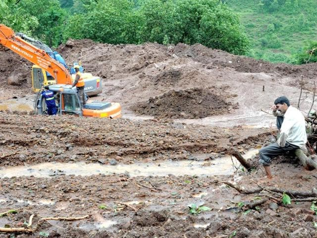 Villager-Chandrakant-Zhanjare-who-lost-13-members-of-his-family-breaks-down-as-he-sits-on-an-uprooted-tree-near-the-spot-which-was-once-his-ancestral-home-at-Malin-Village-AFP-Photo