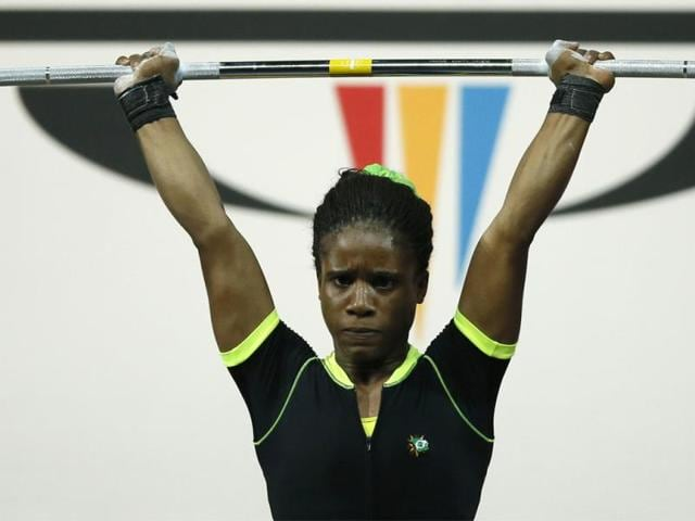 File-photo-of-weightlifter-Chika-Amalaha-of-Nigeria-The-16-year-old-has-been-stripped-of-her-gold-medal-after-a-positive-doping-test-at-the-2014-Commonwealth-Games-Glasgow-AP-Photo