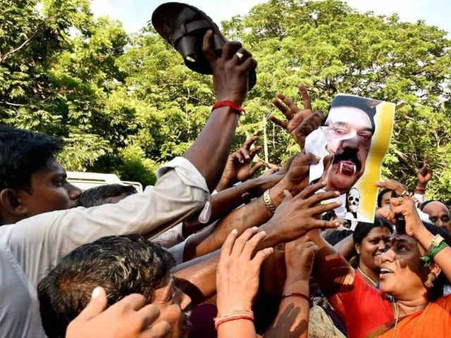 AIADMK-cadres-holding-a-protest-against-Sri-Lankan-President-Mahinda-Rajapakse-in-Chennai-PTI-photo