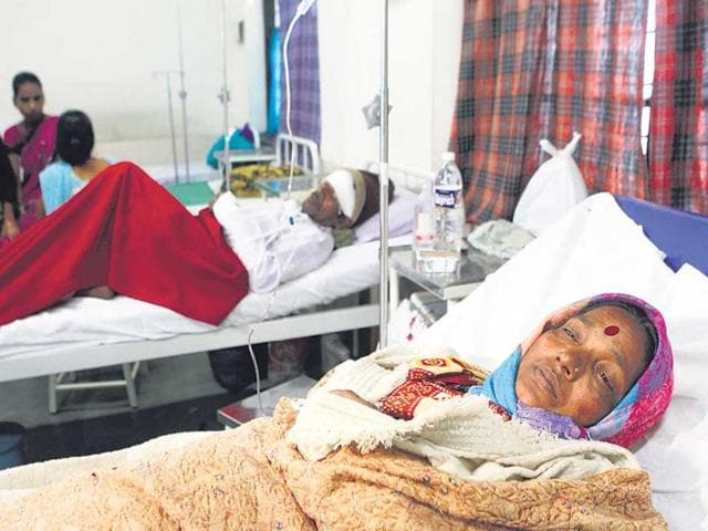Kalubai-Lembhe-and-her-husband-one-of-the-few-survivors-recuperate-at-a-local-hospital-Satish-Bate-HT-photo