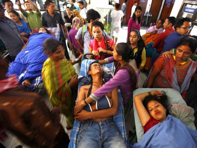 100 likely dead as Nepal landslide blocks river