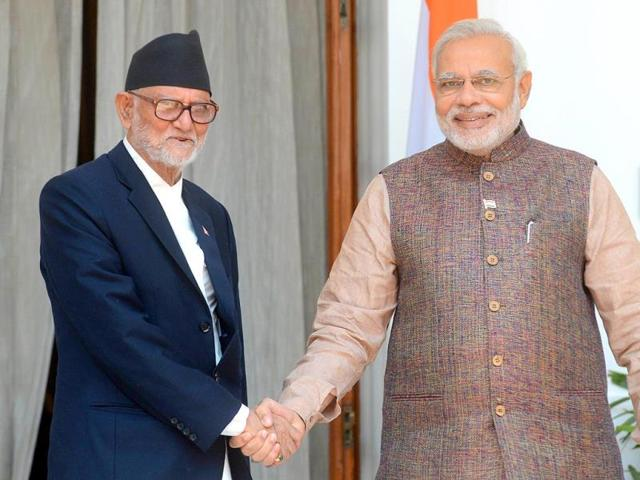 In-this-photograph-taken-on-May-27-2014-Prime-Minister-Narendra-Modi-shakes-hands-with-Nepalese-Prime-Minister-Sushil-Koirala-during-a-meeting-in-New-Delhi-AFP-Photo