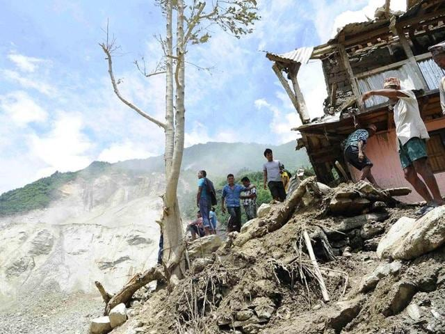 People-are-seen-at-the-landslide-area-in-Sindhupalchowk-district-after-a-massive-landslide-triggered-by-heavy-rains-in-northeast-Nepal-Reuters