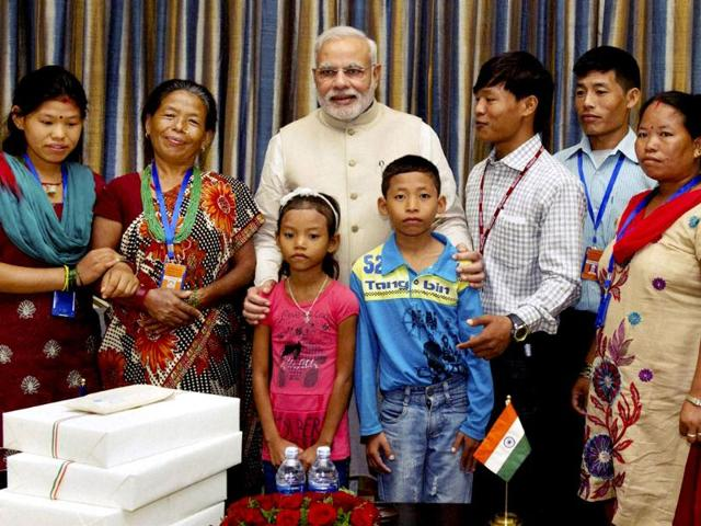 Prime minister Narendra Modi with the family of Jeet Bahadur (3R) in Kathmandu, Nepal. The young boy has been raised by the PM in Gujarat, India. (PTI photo)