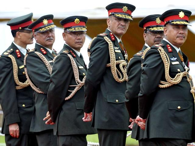 Nepalese Army officers watch Prime Minister Narendra Modi (unseen) on his arrival at Tribhuvan International Airport in Kathmandu. (AFP photo)