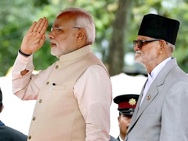 Prime minister Narendra Modi during the official welcome ceremony seen with his Nepalese counterpart Sushil Koirala (L) on arrival at VVIP lounge compound of Tribhuvan International Airport in Kathmandu, Nepal. (PTI photo)