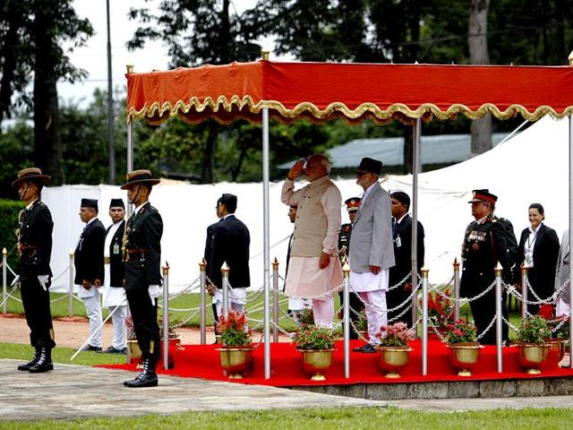 Prime Minister Narendra Modi with his Nepalese counterpart Sushil Koirala receives a guard of honour upon his arrival at Tribhuvan International Airport in Kathmandu. (Reuters)