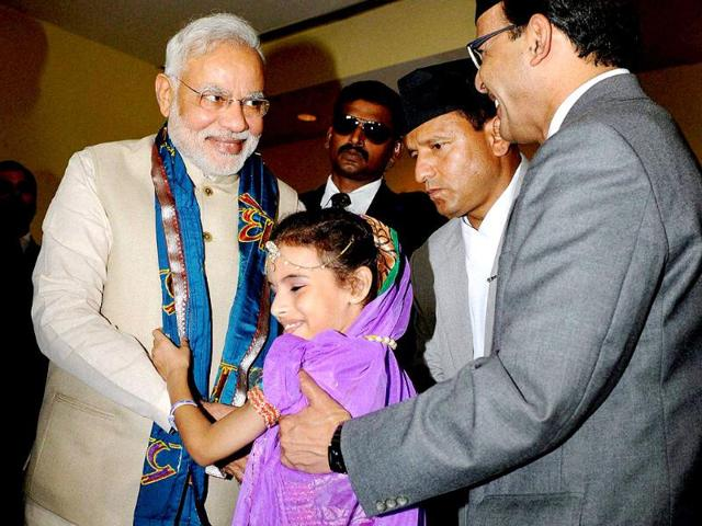 Prime Minister Narendra Modi gets a traditional welcome after reaching the hotel in Kathmandu, Nepal. (PTI photo)