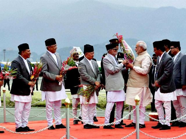 Prime minister Narendra Modi being welcomed by his Nepalese counterpart Sushil Koirala and his cabinet ministers on arrival at Tribhuvan International Airport in Kathmandu, Nepal. (PTI photo)