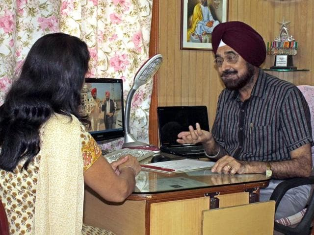 Colonel-Gursewak-Singh-engaged-in-a-discussion-with-a-client-at-his-office-in-Manimajra-Abhishek-Seth-HT