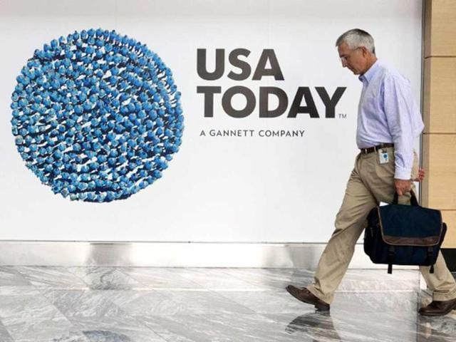 A-file-picture-shows-a-man-walking-through-the-lobby-of-the-Gannett-USA-Today-headquarters-building-in-McLean-Virginia-AFP-photo