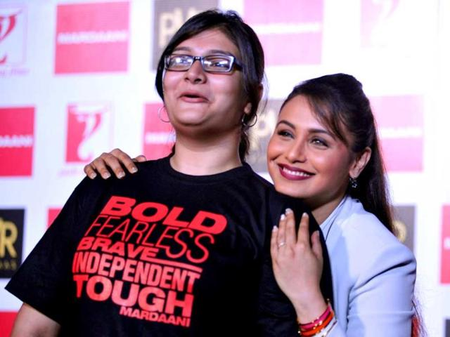 Rani Mukerji poses for a photograph with a fan. (AFP Photo)