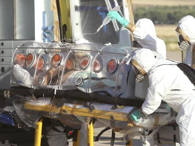 Aid-workers-and-doctors-transfer-Miguel-Pajares-a-Spanish-priest-who-was-infected-with-the-Ebola-virus-while-working-in-Liberia-from-a-plane-to-an-ambulance-as-he-leaves-the-Torrejon-de-Ardoz-military-airbase-Spain-AP-Photo