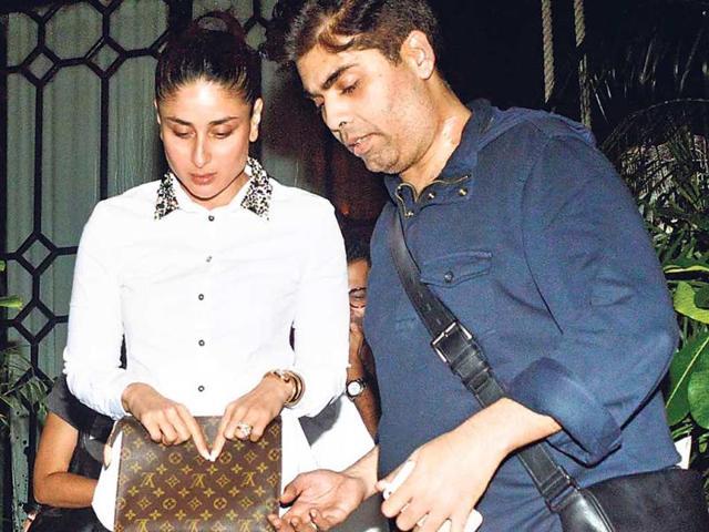Seemed-like-Karan-Johar-was-helping-Kareena-Kapoor-Khan-to-watch-her-steps-at-a-Bandra-Mumbai-restaurant-Photos-Yogen-Shah