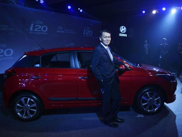 Managing-Director-of-Hyundai-Motor-India-Bs-Seo-poses-for-a-photograph-with-the-newly-launched-Elite-i20-car-during-an-event-in-New-Delhi-on-August-11-2014-The-launch-of-the-new-model-marks-the-global-premier-of-the-second-generation-i20-model-in-India--Photo-AFP