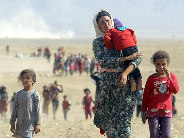 Displaced-people-from-the-minority-Yazidi-sect-fleeing-violence-from-forces-loyal-to-the-Islamic-State-in-Sinjar-town-walk-towards-the-Syrian-border-Reuters-Photo