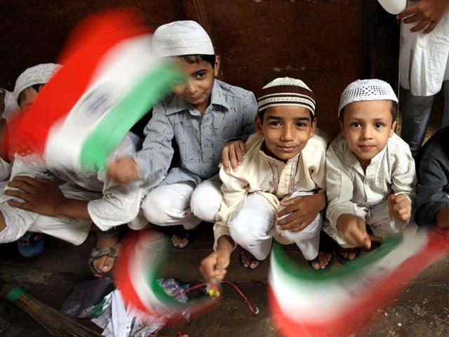 Children holding the national flag and celebrate Independence day at Jama Masjid in New Delhi. (Raj K Raj/HT Photo)