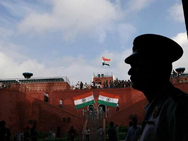 The national flag is hoisted at Red Fort during the full dress rehearsal of Independence Day celebrations in New Delhi. (Raj K Raj/HT Photo)