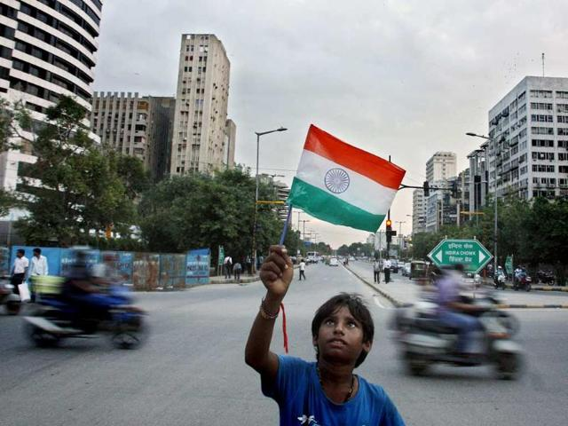 A boy holds an Indian flag in New Delhi. (M Zhazo/HT Photo)
