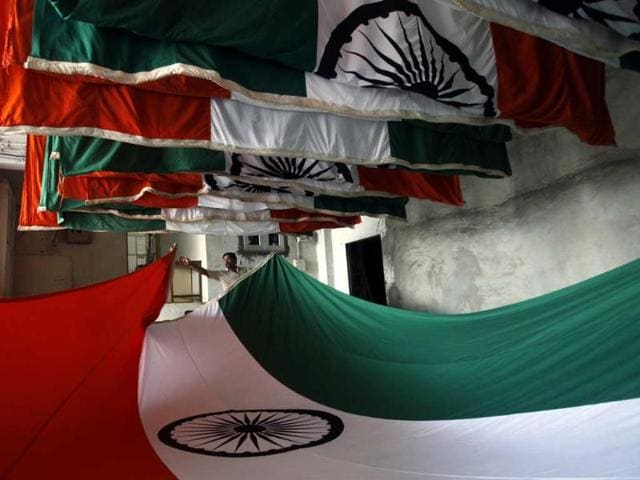 State employees fold the national flag as tricolors are dried at the Mantralaya in Mumbai. (Kunal Patil/HT Photo)