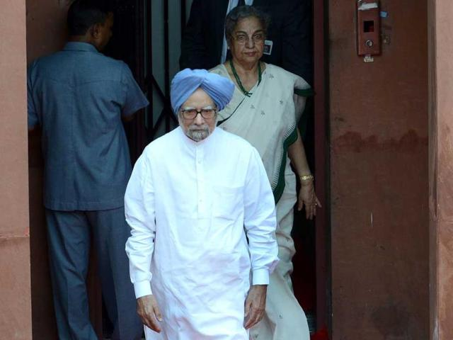 Former Prime Minister Manmohan Singh leaves after the country