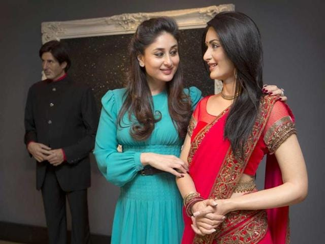 Kareena-Kapoor-comes-faces-to-face-with-her-wax-figure-from-2011-after-donating-a-new-red-sari-with-a-gold-trim-that-she-wore-from-the-film-Ra-One-at-Madame-Tussauds-in-London-Photo-courtesy-AP