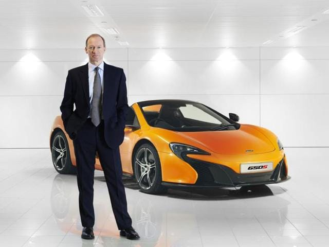 McLaren-Automotive-CEO-Mike-Flewitt-poses-with-the-650S-Photo-AFP